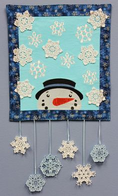 Free project instructions to make an embroidered snowflake wall hanging