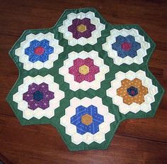 Hand pieced and quilted table topper grandmas flower garden