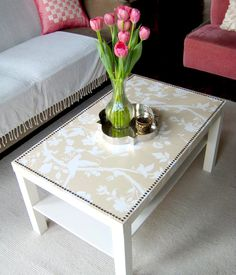 DIY DECOUPAGE IDEAS: recover a cheap coffee table with craft paper and #modpodge; line with thumbtacks