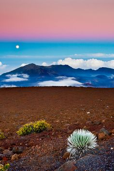 The moon rises over Haleakala crater on Maui