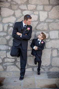 Simon says, mimic the groom! A ring bearer does his best impersonation in this hilarious wall shot.