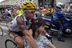 France's Samuel Dumoulin rides with his daughter