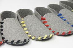 These slippers are constructed from a single piece of natural wool felt & a single string.