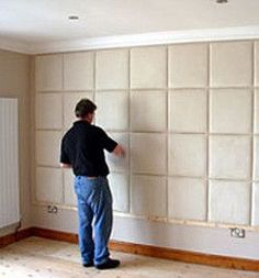 a man putting up padded wall tiles Padded Wall Panels, Upholstered Wall Panels, Bed Headboard Design, Headboards For Beds, Bedroom Wall Designs, Bed Wall, Luxurious Bedrooms, Decoration, Wall Tiles