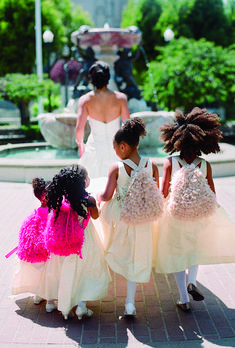 For the flower girls, sweet tulle backpacks from Crewcuts were filled with stickers and other fun items. Photo by Tanja Lippert
