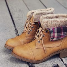 Soft sand tones pair with a cozy sweater knit top and a sweet plaid cuff on these boots. Designed with a lace-up front, fold-over plaid cuff, cozy sweater knit top, and a treaded rubber sole. Perfect