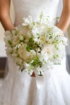 Classic snowy blooms mix beautifully with soft green vines and foliage. The delicate tendrils of the sweet peas bring poetry and a little whimsy to this bouquet. Photo by Christian Oth.