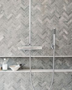 gray herringbone tiles for master shower