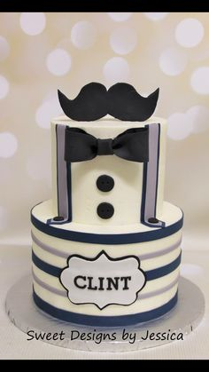 Little man themed baby shower cake with mustache and suspenders