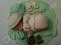 All items are handmade with gumpaste and Satin Ice fondant. Our Babies are a wonderful memento to save from your event as they will last for many years