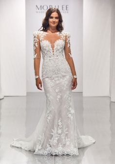 Fit to flare wedding dress in net over Chantilly lace with sweetheart neckline, sheer cap sleeves and detachable long pouf sleeves. Mori Lee Bridal, Mori Lee Wedding Dress, Wedding Dress Sleeves, Bridal Wedding Dresses, Bridal Outfits, Wedding Dress Styles, Lace Wedding, Lace Dress Styles, Designer Bridesmaid Dresses