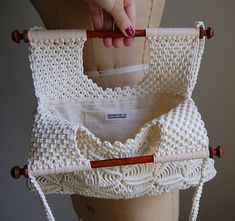 vintage 70s boho hobo hippie macrame purse in cream white color.wooden handles.braided double strap handles.fully lined with pocket.    tag: