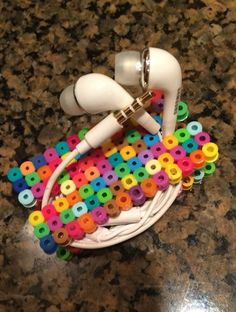 A personal favorite from my Etsy shop https://www.etsy.com/listing/255456229/ear-bud-holder-multi-color