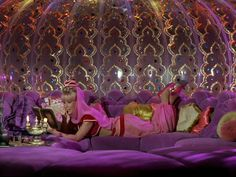 Each Friday, I selected an outrageous, marvelous bedroom right out of my dreams. I LOVE I Dream of Jeannie AND I LOVE her bedroom in her bottle! And..Jeannie reads. Even better.