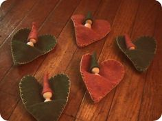 tiny wooden dolls in heart pouches, image via Bending Birches