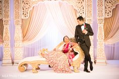 Lavish Indian wedding reception at The Ballantyne in Charlotte, NC. Indian Wedding Poses, Outdoor Indian Wedding, Indian Wedding Receptions, Indian Wedding Couple Photography, Wedding Reception Photography, Pre Wedding Poses, Romantic Wedding Photos, Wedding Photography And Videography, Wedding Couples
