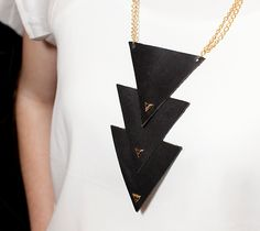 Leather triangle and gold chain. So cute!