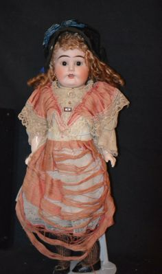 Factory original German bisque doll dress, somewhat worse for wear, but a good example nonetheless.