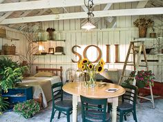 This backyard porch turned guest house plays off the cottage garden feel of the yard. With baskets, potted plants, and vintage finds galore, it gives out-of-town guests privacy and a little oasis to enjoy during down time. (Photo: Van Chaplin)