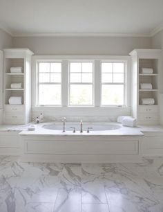Built in tub with marble deck, marble floors ~