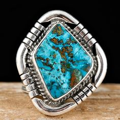 """Portland Plume"" ring, sterling silver, by Albert Jake, Navajo. Set with Portland Plume turquoise, hand stamped"