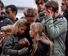 Sorrow: Pain etched on their faces, Parisians have been in mourning today after their country was shaken to the core by the ISIS attacks which left at least 129 dead