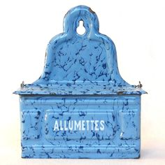 Here is a beautifully enameled old Matches Holder, which features a rather rare light blue and royal blue mottled pattern. The word Allumettes