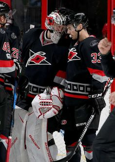 RALEIGH, NC - JANUARY 14: Derek Ryan #33 of the Carolina Hurricanes congratulates Cam Ward #30 on a win following an NHL game against the New York Islanders on January 14, 2017 at PNC Arena in Raleigh, North Carolina. (Photo by Gregg Forwerck/NHLI via Getty Images)