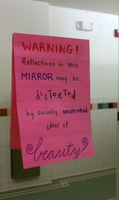 """""""Warning: Reflections in this mirror may be distorted by socially constructed ideas of beauty."""" Yes!"""