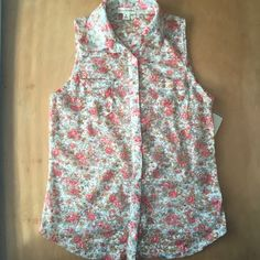 Zenana Outfitters Floral Print Lace Button Up Cute button up. Has two pockets on each side of chest. Really pretty floral print on lace. Is see through. New with tags. ☺️ make an offer and I'll consider Zenana Outfitters Tops