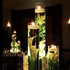 via Savvy Brown: Glue fake flowers to the bottom of a tall vase, fill with water, add floating candles at the top. Instant centerpiece #diy http://instagr.am/p/SeN78MgUNC/
