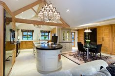The kitchen featuring full length floor to ceiling cupboards