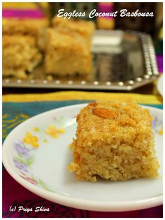 Eggless Coconut Basbousa - mouthwatering middle eastern cake made with semolina, coconut and lovely flavor of rose water!
