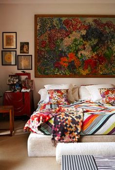 Abstract oil painting with floral pillows.