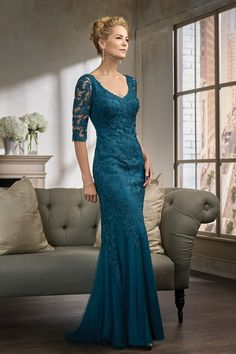 Jasmine Bridal K198007 Netting/Lace with Stretch lining mother of the bride dress with a flattering flare skirt and long, fitted lace sleeves - all in the color new teal. SKIRT LENGTH Sweep train SIZE RANGE 00-30