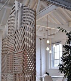 Fun cheap materials used in a smart way to achieve necessary privacy in a public office Gummo office by i29, Amsterdam gold home office desi...