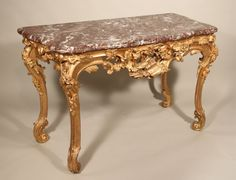#Console table with Dolphins in #gilded #wood, top in #marble. Louis XV, #18th century. For sale on Proantic by Galerie Pellat de Villedon.