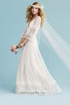 Style Inspiration: The 1970s | Boho-chic brides during the '70s donned free-flowing dresses and leg-of-mutton sleeves, which had full gathers and buttoned cuffs. Sleeveless wedding gowns also became more mainstream during this time. Cutting-edge brides and grooms wore matching ensembles