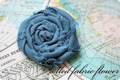 How to make a roll flower out of material and hot glue!