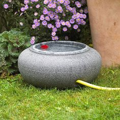 Do Double Duty  Look for clever combinations to save space. Here, a stylish container for a garden hose has a lid so it doubles as a birdbath when not in use. Watch for such products at your local garden center or get creative and make some yourself!