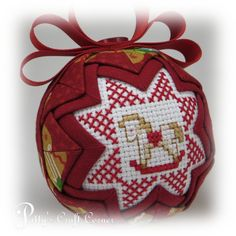 """$15 for sale Etsy 2017 This handmade double sided Quilted Ornament measures 3"""" in diameter and is made with precisely folded material, a cross-stitch design on each side, many tiny sequin pins and topped with a hand sewn grosgrain bow on top. This particular o..."""