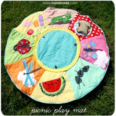 This is like a quiet book/picnic blanket.  It would be awesome for a baby who can't crawl yet so that they can still play at the park.