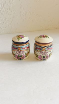 Floral Handpainted Salt & Pepper Shakers Pottery Liceagu, Mexico Cottage Chic by Halfmoonblues on Etsy https://www.etsy.com/listing/224795872/floral-handpainted-salt-pepper-shakers