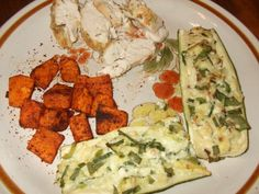 Stuffed zuchinni boats (zuchini, Laughing Cow Garlic & Herb, Light Feta, mushroom, chive, green pepper, spinach), sweet potato baked withy olive oil and chili powder, and chicken breast baked with olive oil/rosemary.