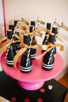 Mini champagne bottles with black & white stripey straws? Yes, please! Calligraphy by Laura Hoooper & Photo by Lauren Rae Photo http://www.theperfectpalette.com/2014/01/a-chic-and-swanky-kate-spade-inspired.html