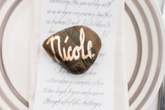 Rock place card | LH Photography | see more on:  http://burnettsboards.com/2015/04/vintage-glam-wedding/