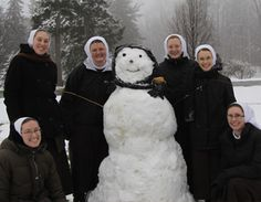 Sisters of Saint Francis of Perpetual Adoration with a snowman