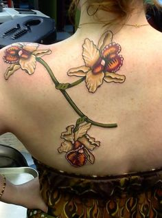 98eb606bdd916 This is my fifth tattoo and it is located on my upper back. It is an  (unfinished) group of Cattleya dowiana orchids. It was done by Kenny Dick  at Lucky 7 ...