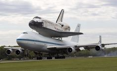 The space shuttle Discovery, sitting atop a 747 carrier aircraft, lands at Dulles International Airport in Chantilly, Va., Tuesday, April 17, 2012.