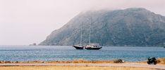 a sailing boat at the bay of Diakoptis in Patmos